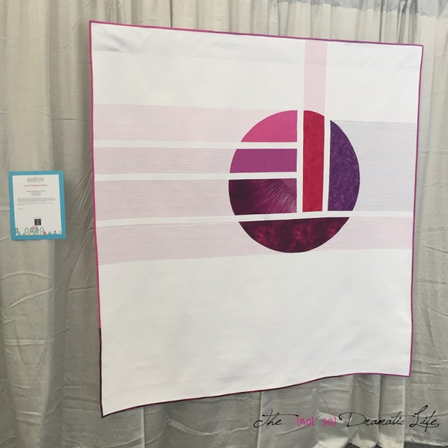 The Whole is Greater Than the Sum of Its Parts hanging at QuiltCon