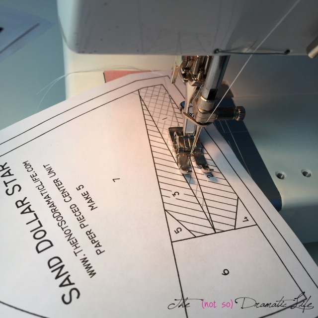 Stitching along the line on the paper piecing template